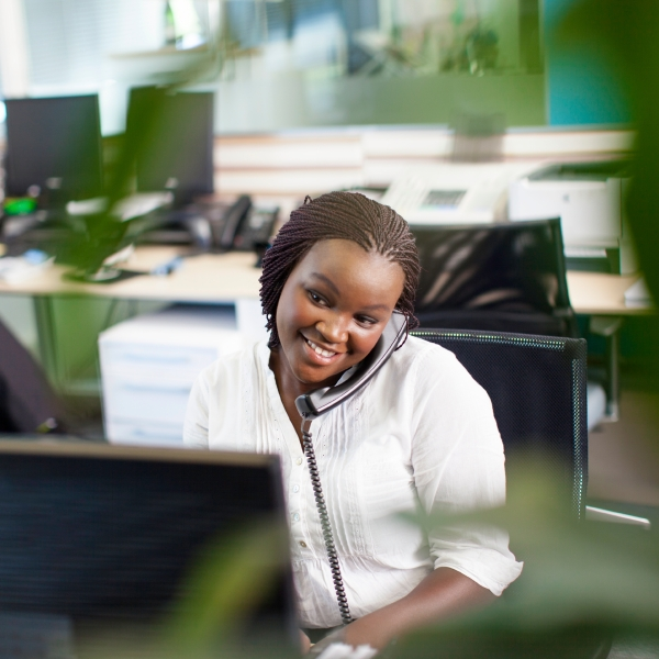 Stock image of a woman providing quality customer service.